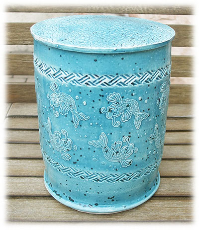 Urn made with rollers and stamps
