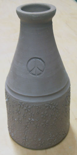 bottle stamped and rolled for surface texture